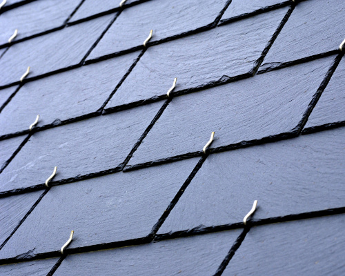 up close shot of slate roofing with clips to secure the materials