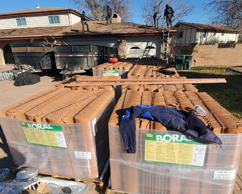 boral tile roofing being loaded onto a roof