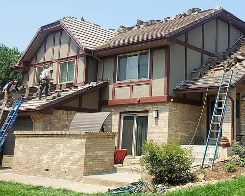 concrete tile roofing being installed by a roofing contractor