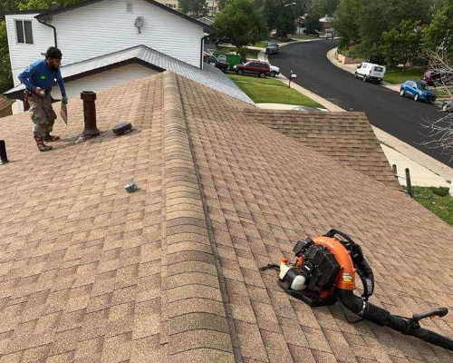 finishing up a roofing shingle installation in lakewood