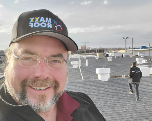 al lamp of laxx roof llc standing on a clients roof